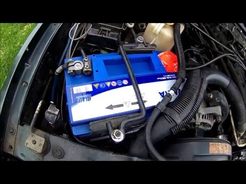 The Drilled Battery Checking Fluid Level In A Maintenance Free