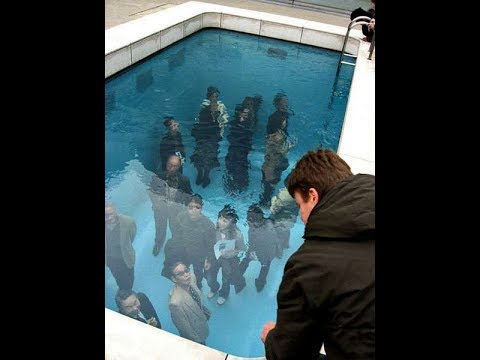 Optical illusion Swimming Pool in Japan makes People look like they're Underwater