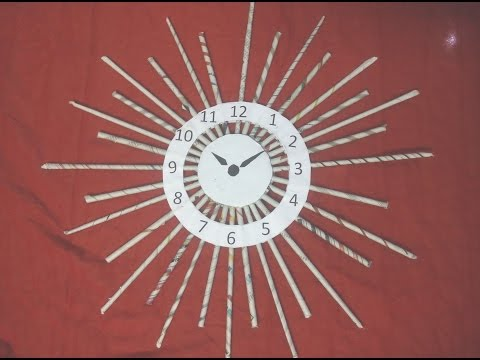 DIY: How to make wall clock with news paper tubes/ rolls  - sun model - best out of waste craft