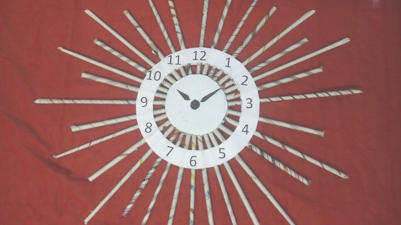 Diy how to make wall clock with news paper tubes rolls for Model on best out of waste