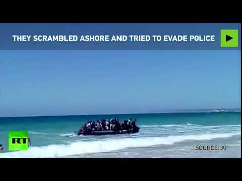 Sunbathers shocked as dinghy of migrants lands on beach