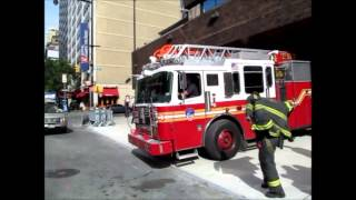 FDNY Engine 54, Ladder 4, Battalion 9 responding CODE 3 from the station.