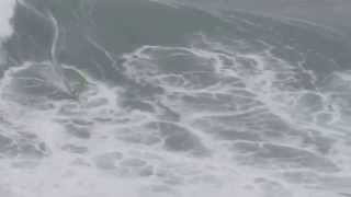 Big Wave Surfing By Nazare Lighthouse
