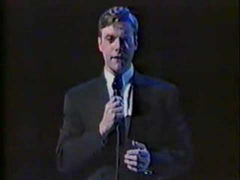 A younger Anthony Warlow sings