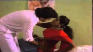 Tamil patient getting navel checked by doctor