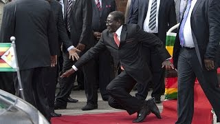 WATCH: Robert Mugabe falls down steps in Harare