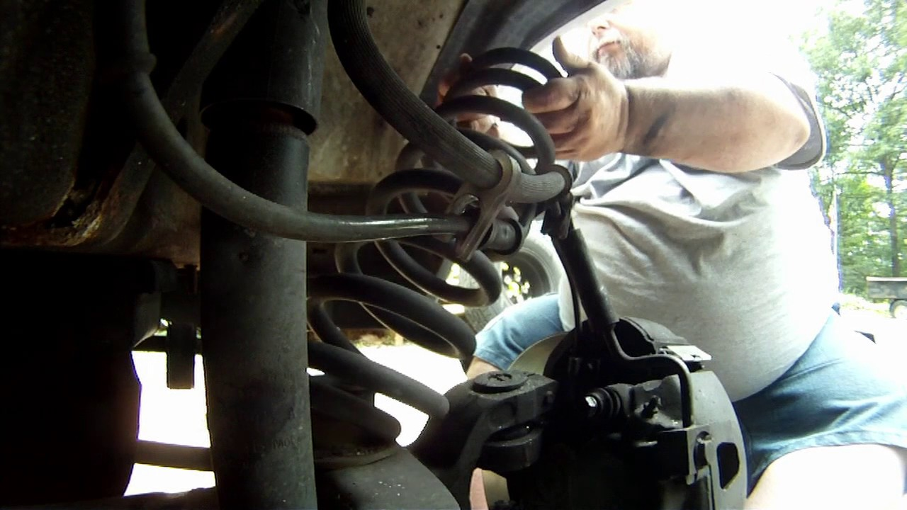 1999 Ford E150, Radius Arm-To-Axle Bolt Almost Fell Out And Coil Spring  Replacement
