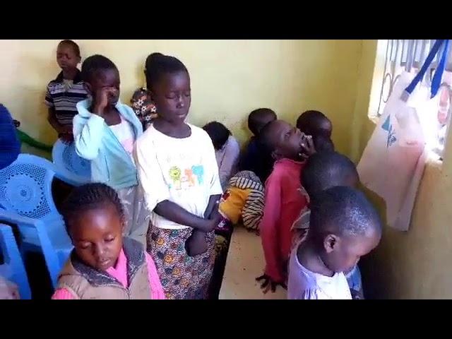 Haron Praying for Children - GMFC / WFF Moi's Bridge Kenya 10-14-2018