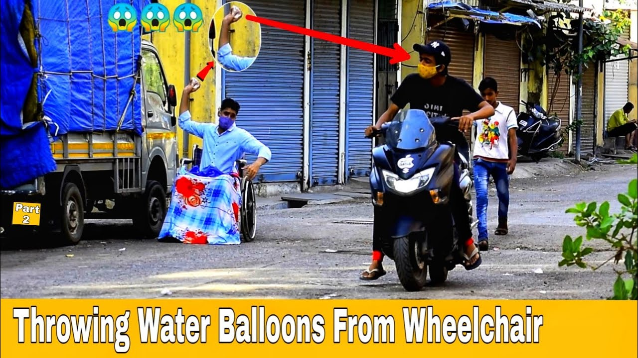 Throwing Water Balloons From Wheelchair   Throwing Water Balloons Prank   Prakash Peswani Prank  