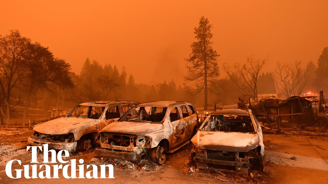 'A massive wall of fire': wildfires rage in California