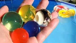 БОЛЬШИЕ ORBEEZ Выращиваем в воде огромные шары орбиз Купаемся В БАССЕЙНЕ Шарики растущие в воде