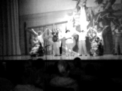 Nic performing in the WCMS talent show in b&w like in the 1960s