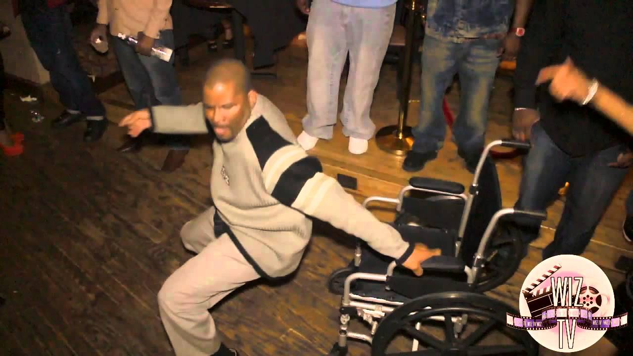 Man In A Wheel Chair Dancing With Women For His Birthday