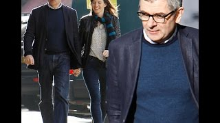 Rowan Atkinson and his girlfriend Louise Ford held hands as they took a walk through an area of nort