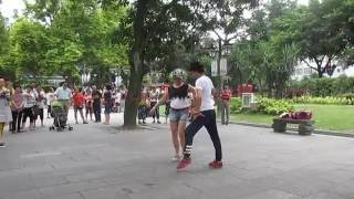 Chinese salsa dance performance in a park, Fushu China