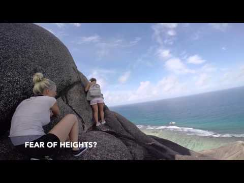 Climbing The Turtle Rock Anse Source d'Argent La Digue Seychelles - Sunny Trail Guide