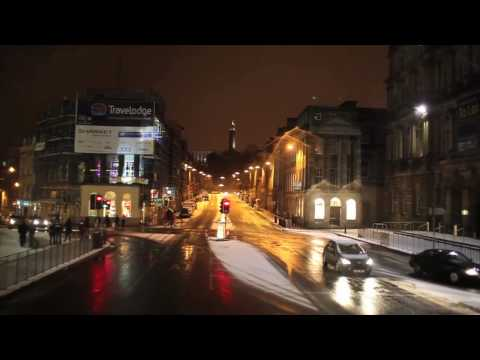 Driving a bus in the center of Edinburgh. Night time, winter and some snow.