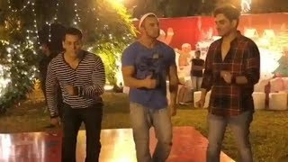 Salman Khan takes the dance floor with brothers Sohail and Arbaaz at his Christmas party.