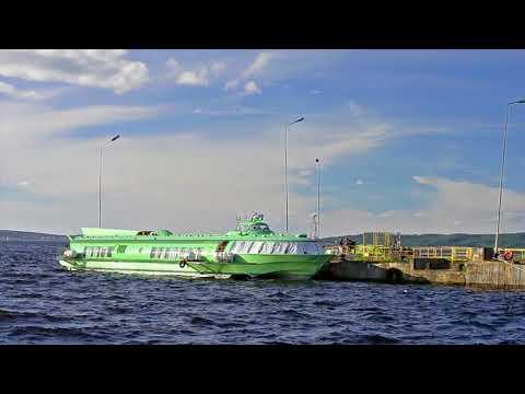 Boat on underwater wings moored at pier lake Onega