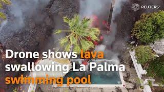 Drone shows lava swallowing La Palma swimming pool