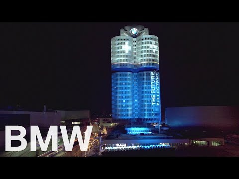 BMW Headquarters Tower in Munich lit up like a battery.