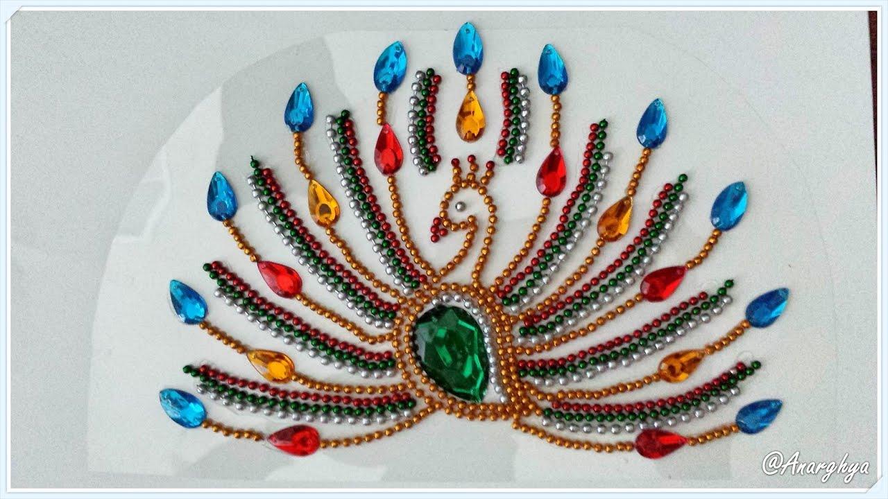 Peacock kundan rangoli youtube for Home made rangoli designs