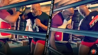 MIKE TYSON THROWING POWER HOOKS IN WORKOUT! TEACHES HENRY CEJUDO HIS SIGNATURE HOOKS DURING TRAINING