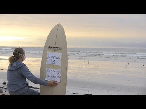 Surfers protest against lockdown in South Africa | AFP
