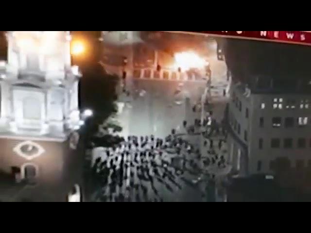 Boston Police vehicle being burned.