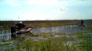 airboat pulling bass boat