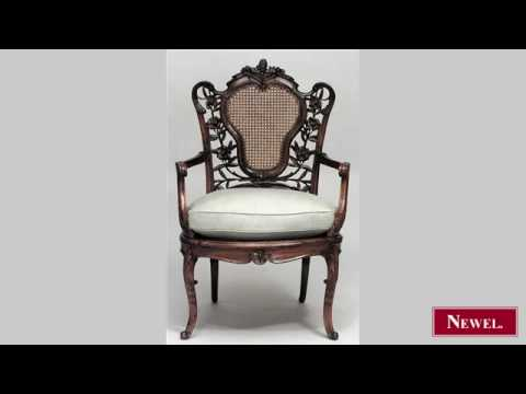 Antique French Art Nouveau walnut arm chair with carved