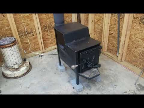 Fisher baby bear wood stove and chimney pipe installation