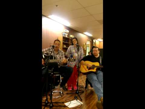 Volunteers singing at the Austin Adult Day Health Center