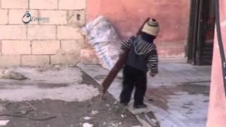وكالة قاسيون  طفل سوري يجمع الحطب لمكافحة برد الشتاء 7-12-2015
