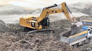 Caterpillar 390F Excavator Loading Mercedes Arocs Trucks