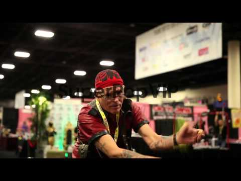 Mid shot EXXXOTICA Expo member, present how to use his me...