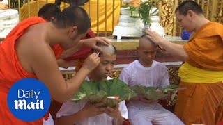 Thai cave boys have their heads shaved in Buddhist ritual