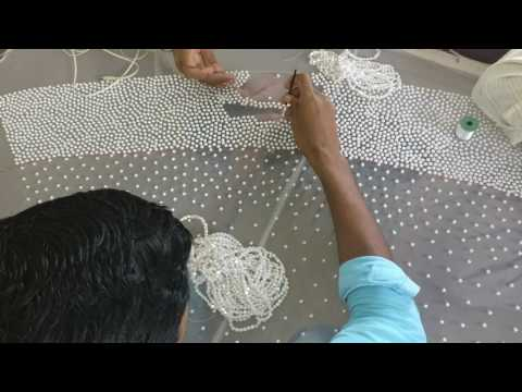 Pearl work embroidery for a white christian wedding gown