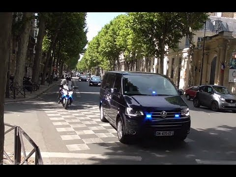 Police escort French government cars in Paris