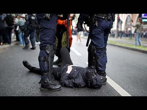 Police and protesters clash in Paris