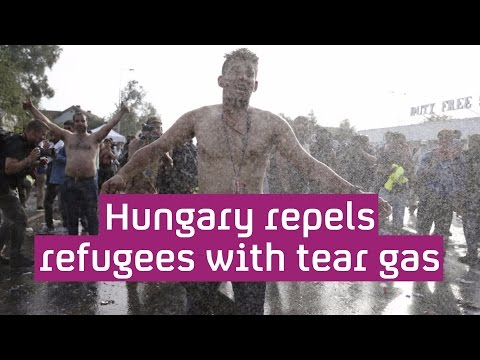 Refugee crisis: Hungary uses water cannon as people head to