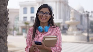 Beautiful Indian girl in glass spectacles smiling while looking at the camera