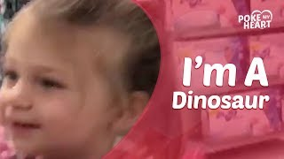 Adorable Little Girl Wears Giant Dinosaur Head