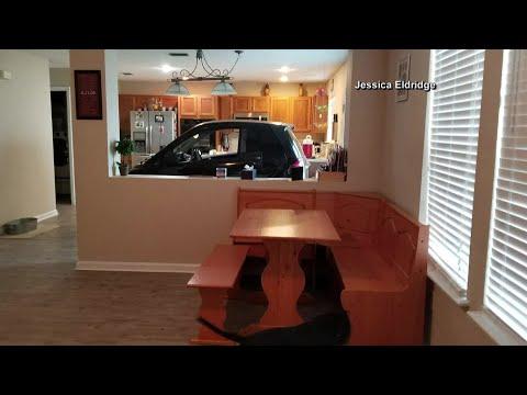Kitchen doubles as parking garage for Smart car