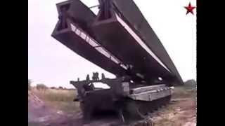 Российские танки преодолевают 15-метровые рвы на учениях «Восток-2014»(В ходе учений «Восток-2014» общевойсковые и танковые подразделения в кратчайшие сроки преодолевали рвы прот..., 2014-09-23T13:29:28.000Z)