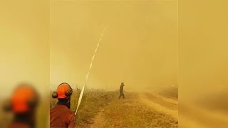 Fire tornado filmed snatching hose from Canadian firefighters