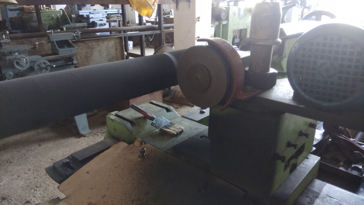 Rubber Roller Grinding using Lathe Machine