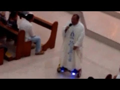 Priest suspended after hoverboarding down church aisle
