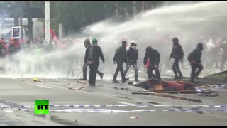 Police use water cannon against anti-austerity protesters in Brussels