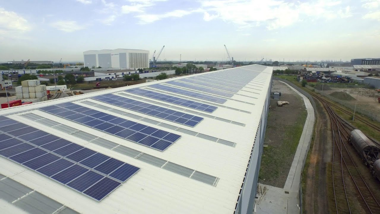 Solar panels on a warehouse using steel metal cladding and roofing systems - YouTube & Solar panels on a warehouse using steel metal cladding and roofing ... memphite.com
